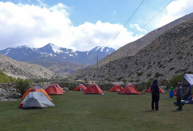 Base camp tents within the walled compound