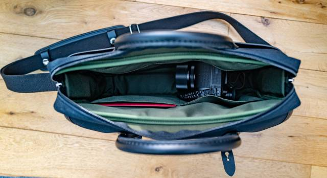 The SL2 and most smaller cameras will jsut about fit into the Thomas. While there is no extra side side protection, the bottom and edges of the main compartment are padded to offer support for electronic equipment.