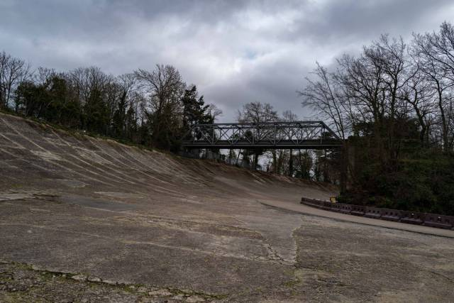 Deserted. The 1907 banked racing circuit, one of the wonders of the age, with the Members' Bridge crossing to nowhere. 18 March 2020, Leica Q2