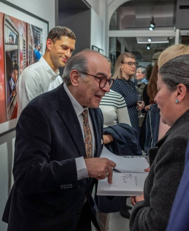 Signing the book, 24 October 2019 (Image Tony Cole)