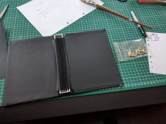 Glue some end papers over the excess cover material