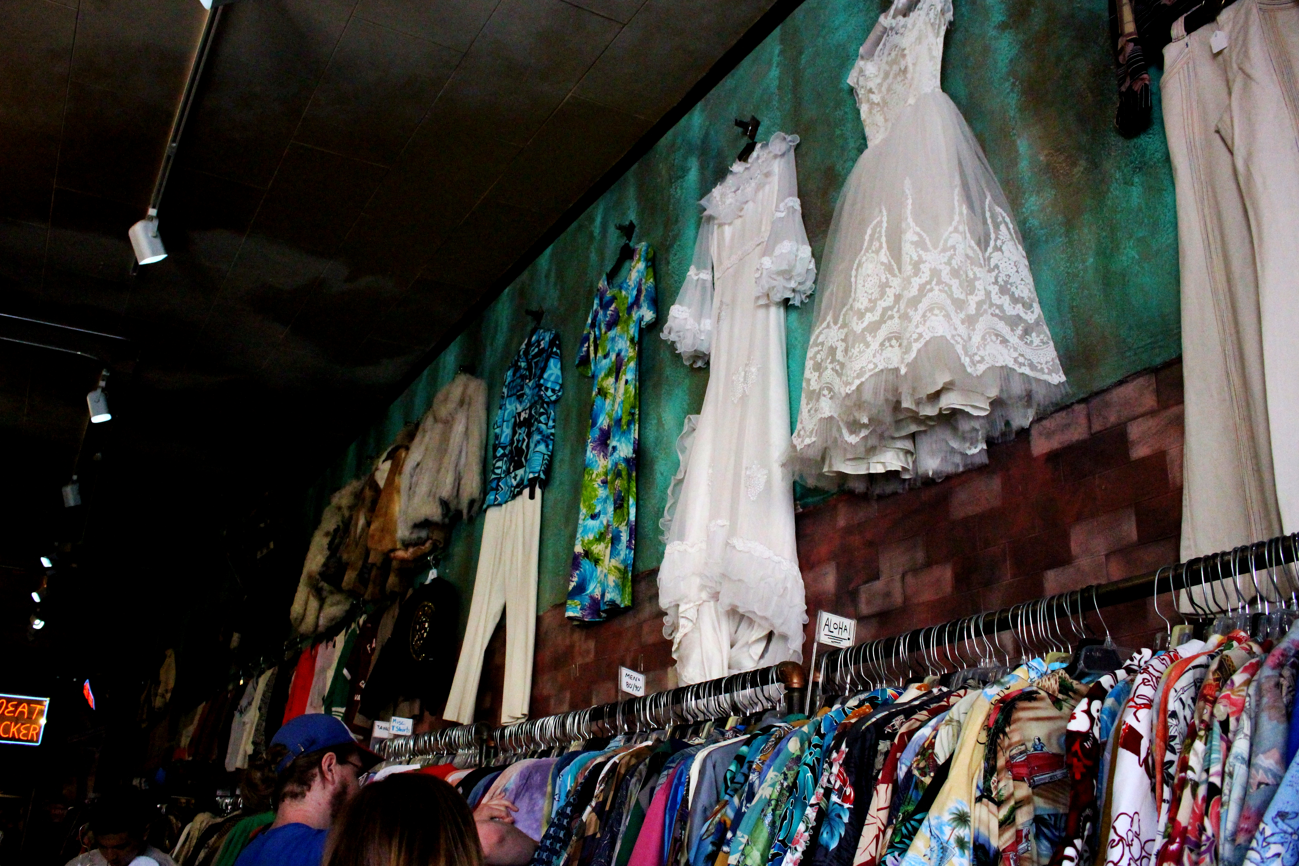 Dresses are hung up on walls to display. Credit: Fiona Belk / M-A Chronicle.