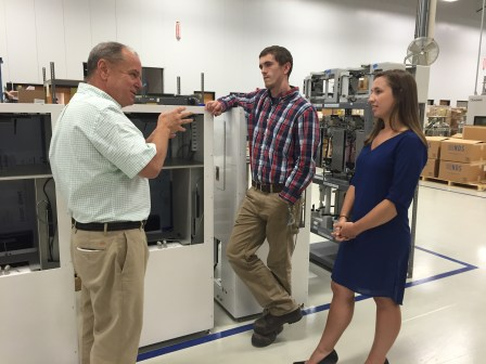 From left, clockwise, Mack Molding President Jeff Somple discusses one of the Company's new programs with Finishing Technician Matt Comar and Program Coordinator Britney Coley. Comar and Coley are former interns who have recently returned to Mack as full-time employees.