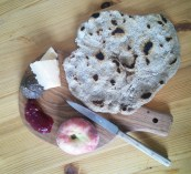 Leve (flatbread), a peach, Prima Donna (hard cheese), sausage and some lingonberry jam (from IKEA)