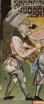 Man with a basket full of stuff. He is wearing very worn chausses, a very short tunic, braies and a hood. late 1300's