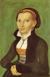 German fashion: Katharina von Bora wears a front-laced grayish gown with black trim. She wears a white partlet edged in black, and her hair is confined in a net or snood, 1526.