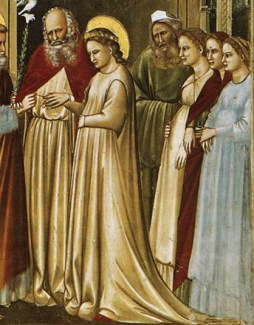 The virgin is wearing a cyclas and matching cote. In the background the ladies are wearing cote that are tucked under their breasts, 1305