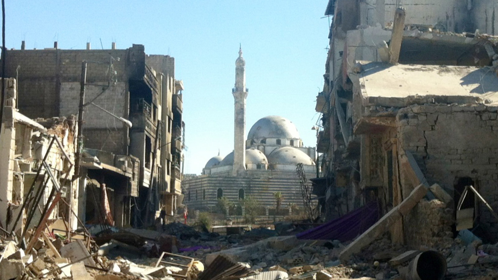 July 2013: Damaged buildings in front of the Khaled bin Walid mosque in the central Syrian city of Homs. (Sam Skaine, Getty)