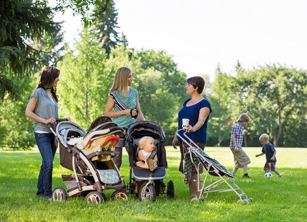 Mothers in a park. (Tyler Olson/Shutterstock)