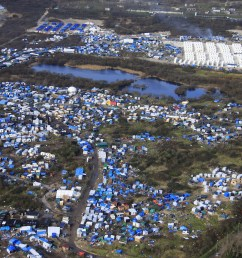 aerial view of a makeshift camp as containers rear are put into place to [ 5184 x 3456 Pixel ]