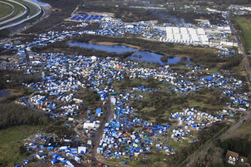 small resolution of aerial view of a makeshift camp as containers rear are put into place to