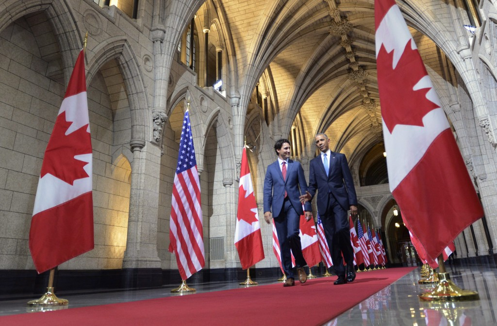 U.S. President Barack Obama and Prime Minister Justin Trudeau walk down the Hall of Honour on Parliament Hill Wednesday, June 29, 2016 in Ottawa. THE CANADIAN PRESS/Paul Chiasson