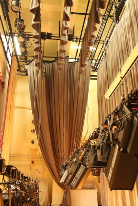 Rigging: Lighting bars and curtains are motorized and managed by a hoist control system.
