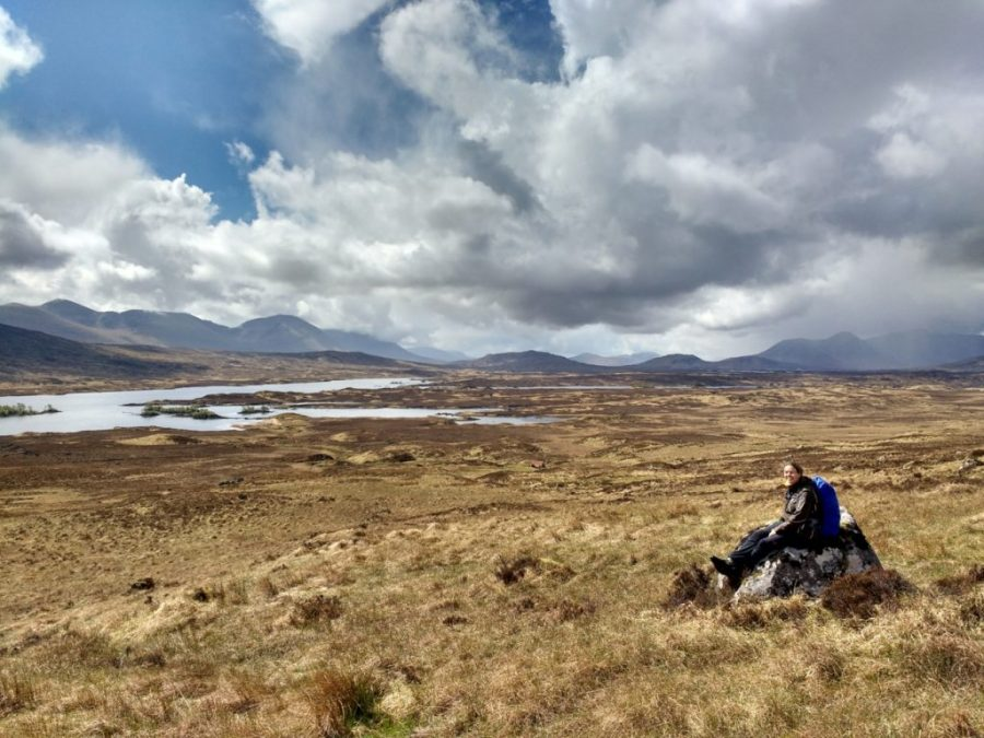 Hiker sits on the Rannoch Moor on the West Highland Way