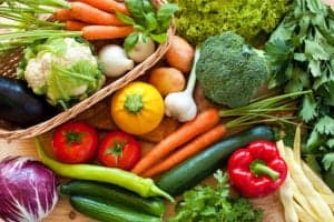assortment of raw vegetables sitting on a table
