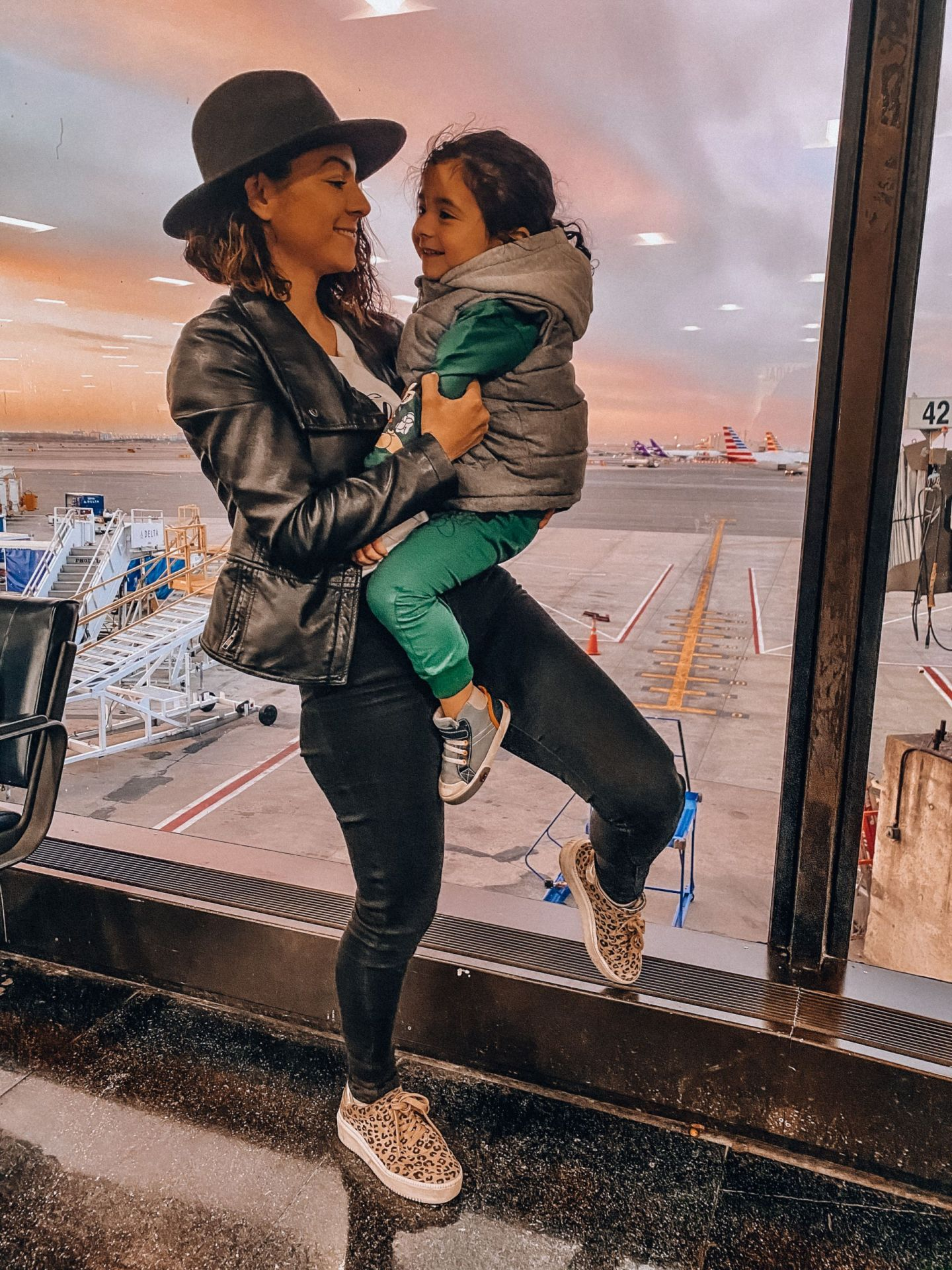 Laura Nava and toddler son at EWR airport