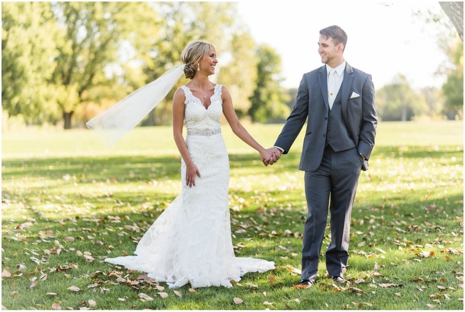 Bride with veil in fall windy wedding | Maddie Peschong Photography