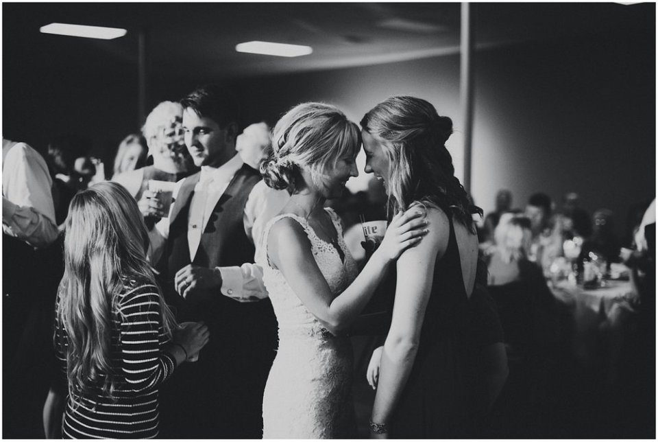 Bride and friends at wedding reception | Maddie Peschong Photography