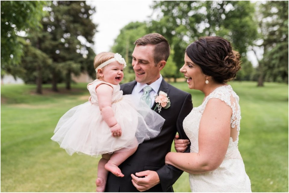 Flower girl with bride and groom | Maddie Peschong Photography
