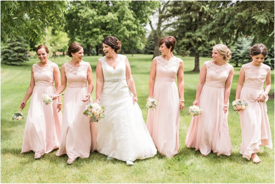 Bride and blush bridesmaids walking | Maddie Peschong Photography