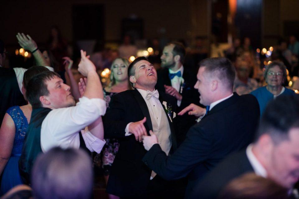 groom dancing at wedding reception