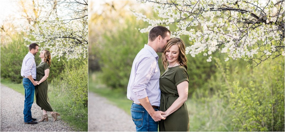 couple engagement photos under flowering tree
