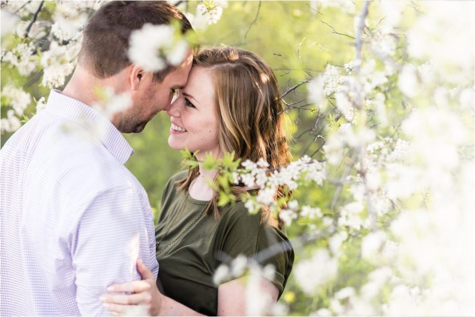 couple looking at each other under tree