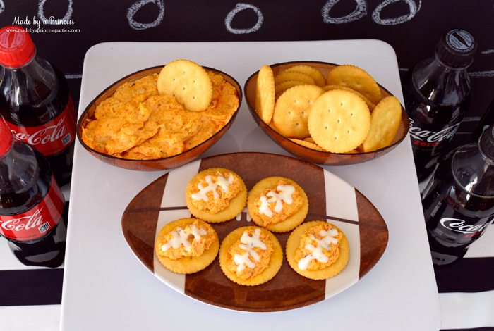 crock pot buffalo chicken dip on ritz crackers footballs
