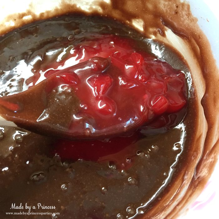 mason-jar-cherry-brownies-mix-filling-into-brownie-batter