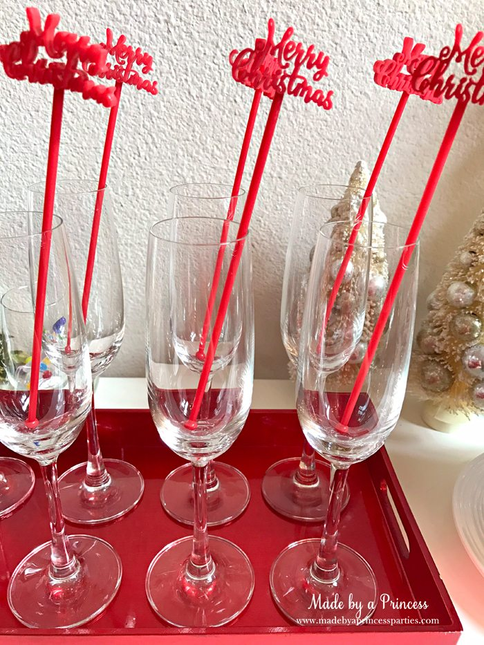 budget-friendly-holiday-mimosa-bar-party-merry-christmas-drink-stirrers-in-glasses