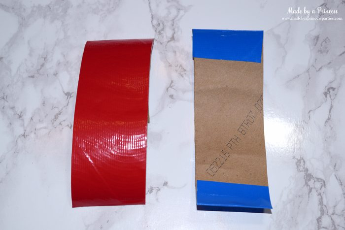 Party-Costume-Idea-How-to-Make-Superhero-Cuffs-place-duct-tape-on-toilet-paper-roll