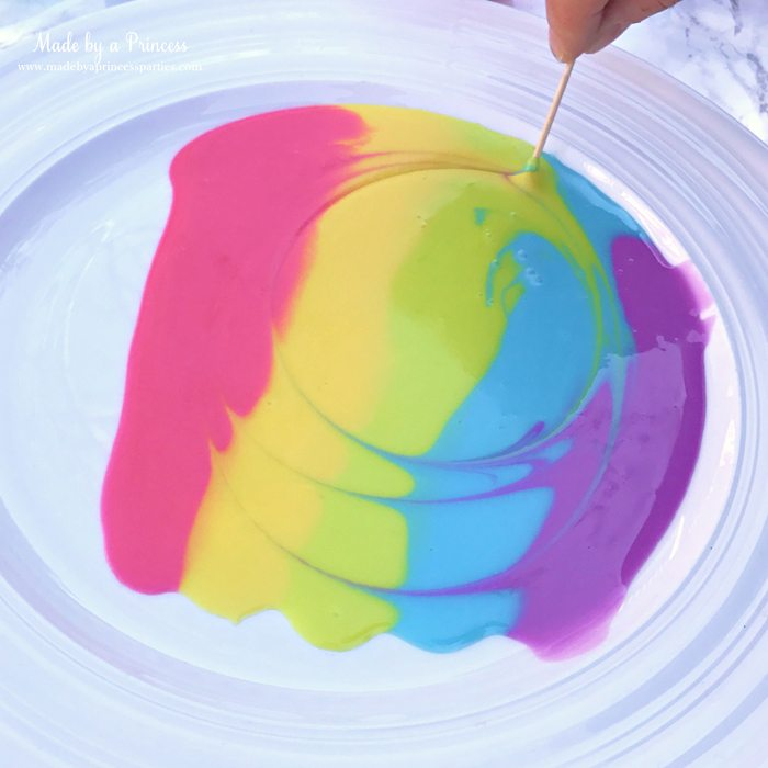 Rainbow Donuts Party Food Tutorial take a toothpick and swirl the glaze