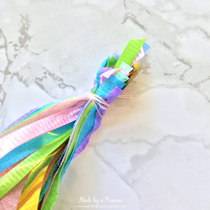 unicorn princess party hat idea tutorial wrap thread around crepe layers and curling ribbon