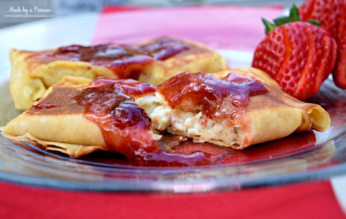 Savory Strawberry Preserves Toasted Coconut Almond Chicken Blintz Recipe filled with ricotta cream cheese and lemon zest