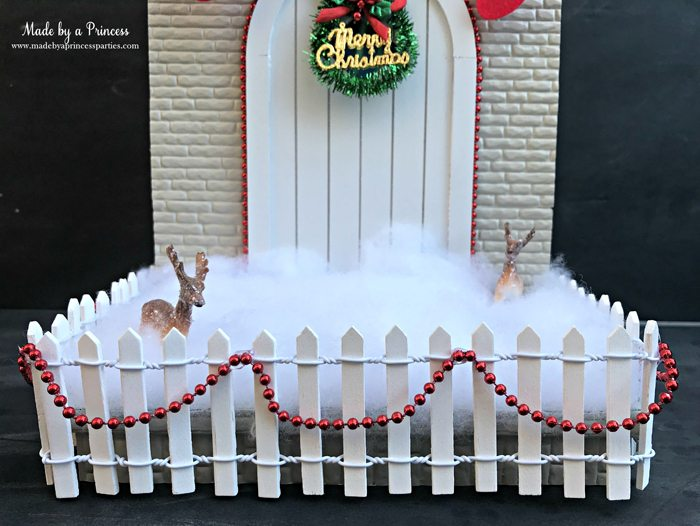 How to Create Your Own Tiny Elf Door Tutorial add fence and snow to MadebyaPrincess #elfdoor #fairydoor #elfdoorkit