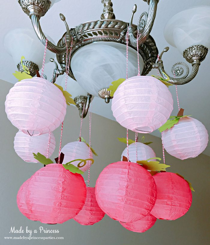 Pink Pumpkin Halloween Party Ideas paper lanterns turned to pumpkins Made by a Princess #pinkparty #pinkoween #pinkpumpkinparty