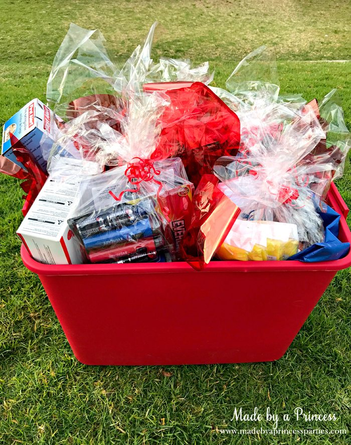 Unique School Silent Auction Idea Emergency Preparedness Kit items wrapped in cellophane and placed in bucket with ribbon