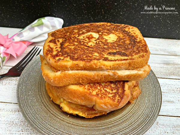 Once marzipan stuffed french toast is golden brown on both sides plate and serve