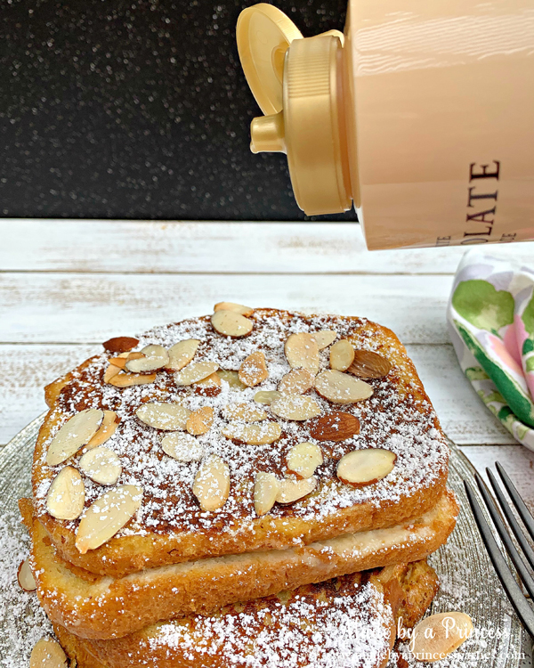Pour Torani White Chocolate Sauce on top of marzipan stuffed french toast