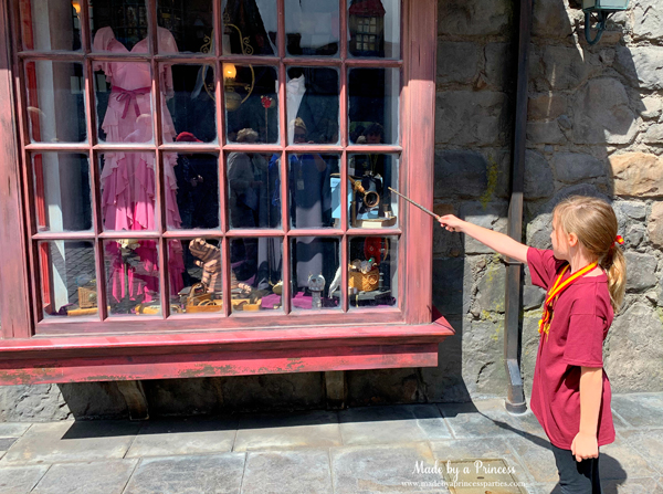 Universal Studios Hollywood make the making tape go up and down with your wand in the window at Gladrags