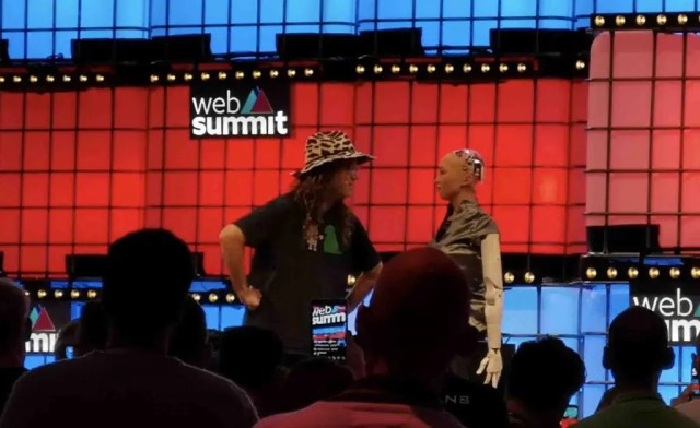 Ben Goertzel demonstrating the power of combined AI and the Singularity with Sophia the Robot at Web Summit
