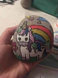 rock painted with unicorn
