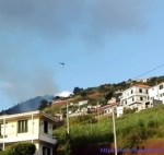 Helicopter fighting fire in the Lombada da Ponta do Sol