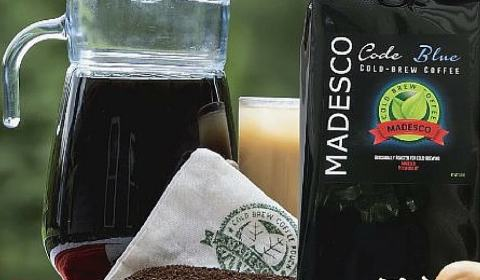 A picture of Madesco Coffee grounds and a pitcher of iced coffee