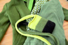 Grün auf Stadtmantel, Blätterbluse und Jacke.