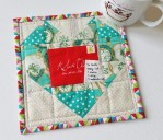 Mad For Fabric - Scrappy Fussy Cut Heart Christmas Mug Rug