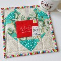 Mad For Fabric - Scrappy Fussy Cut Heart Christmas Mug Rug
