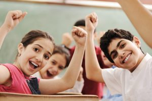 children cheering smiling happy exited