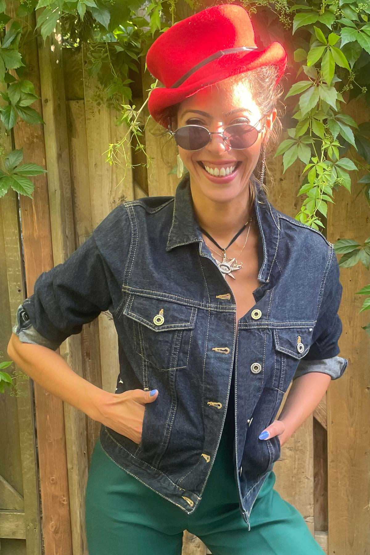 girl with denim jacket and red hat