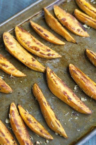 Rosemary Garlic Sweet Potato Wedges are packed with flavor and baked until crisp on the outside and tender on the inside!